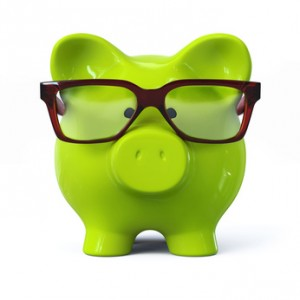 Green piggy bank with glasses - front view